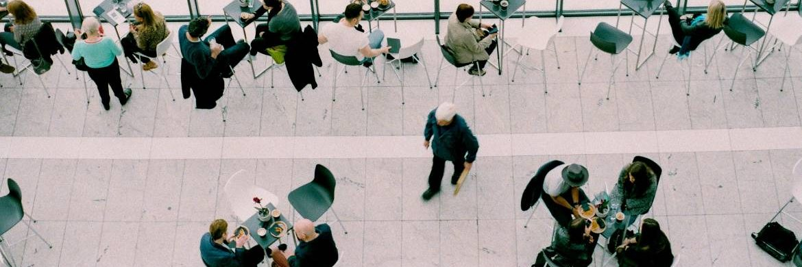Image of a diverse range of people working in a flexible way in a lobby area