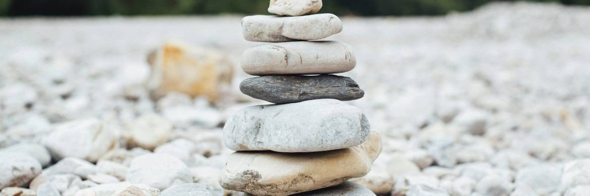 Image of a stack of different sized rocks to illustrate stability
